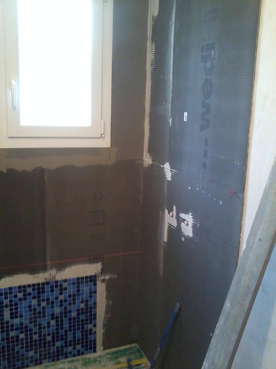 Habillage d'une douche à l'italienne avec des panneaux wedi
